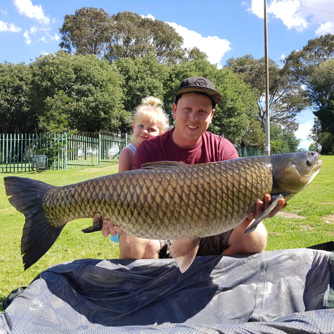 how to, wefish, south africa, johannesburg damn, water, river, hot spot, spots, sport, Man holding a rare Grass Carp trophy pose.